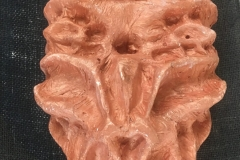 Mask, plaster cast and copper paint
